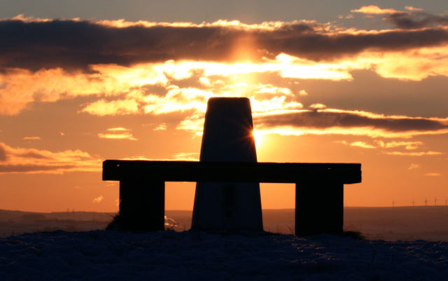 Sunset from a snow covered trig point. Paul Marfell